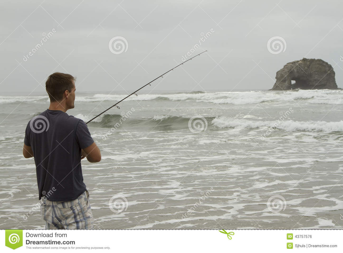 Man fishing in the surf on rockaway beach stock photo for Seaside oregon fishing