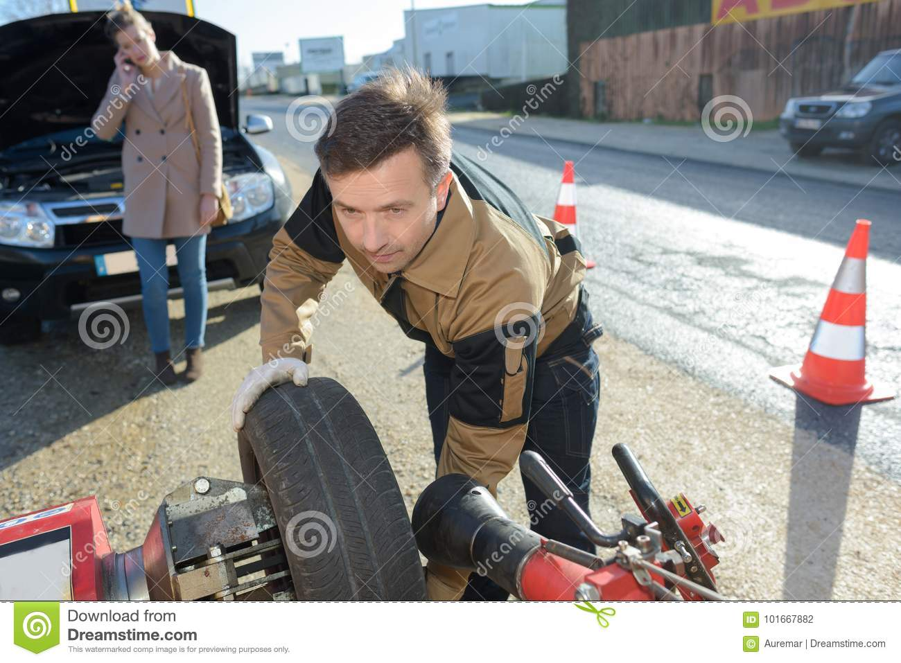 Man fixing car problem after vehicle breakdown