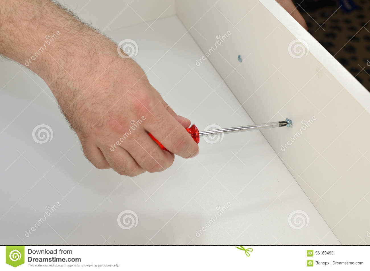 Man is Fixing a Drawer Pull