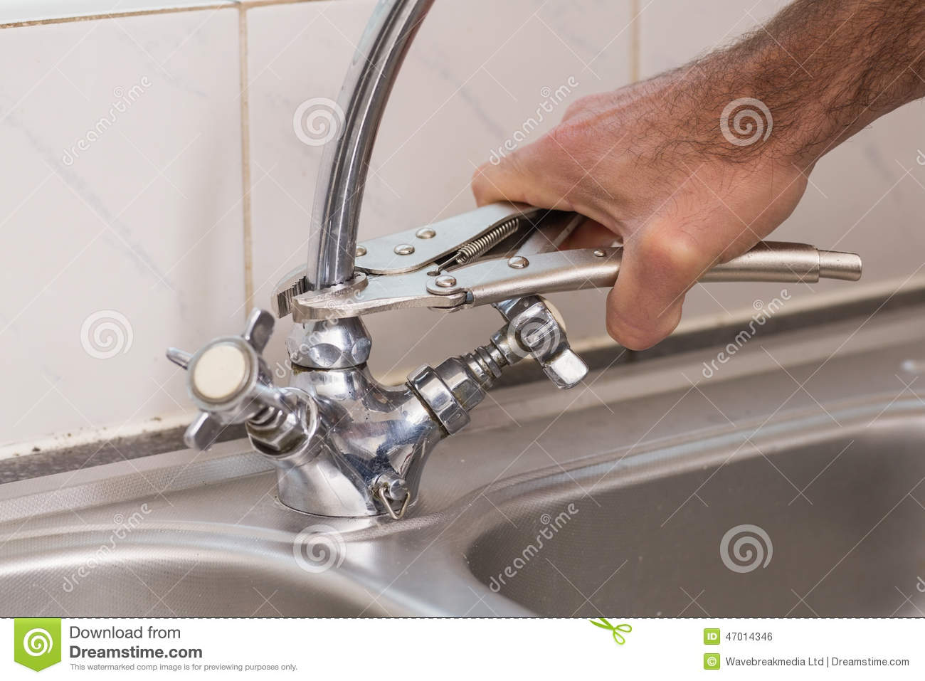 Man fixing tap with pliers stock photo. Image of part - 47014346