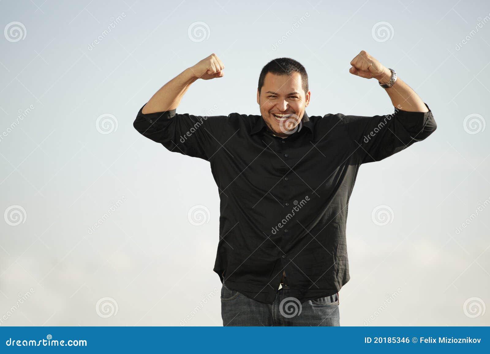Man flexing his arms