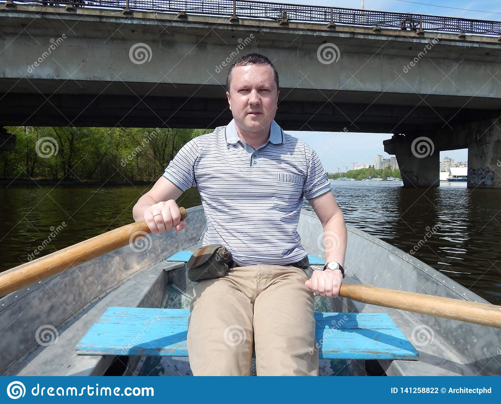A man floating on a boat rides with