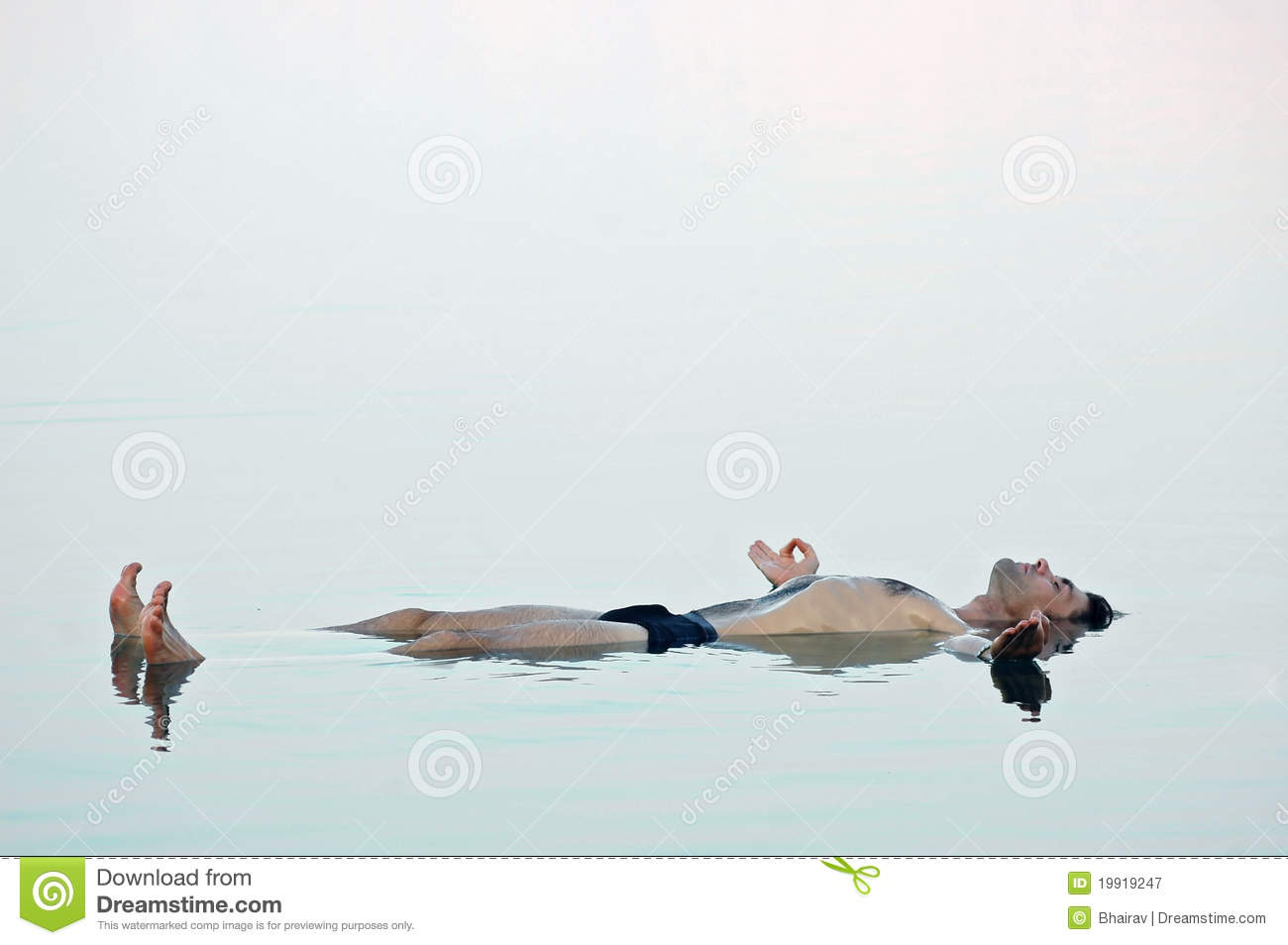 Man Floating In A Glassy Water Of Dead Sea Royalty Free ...