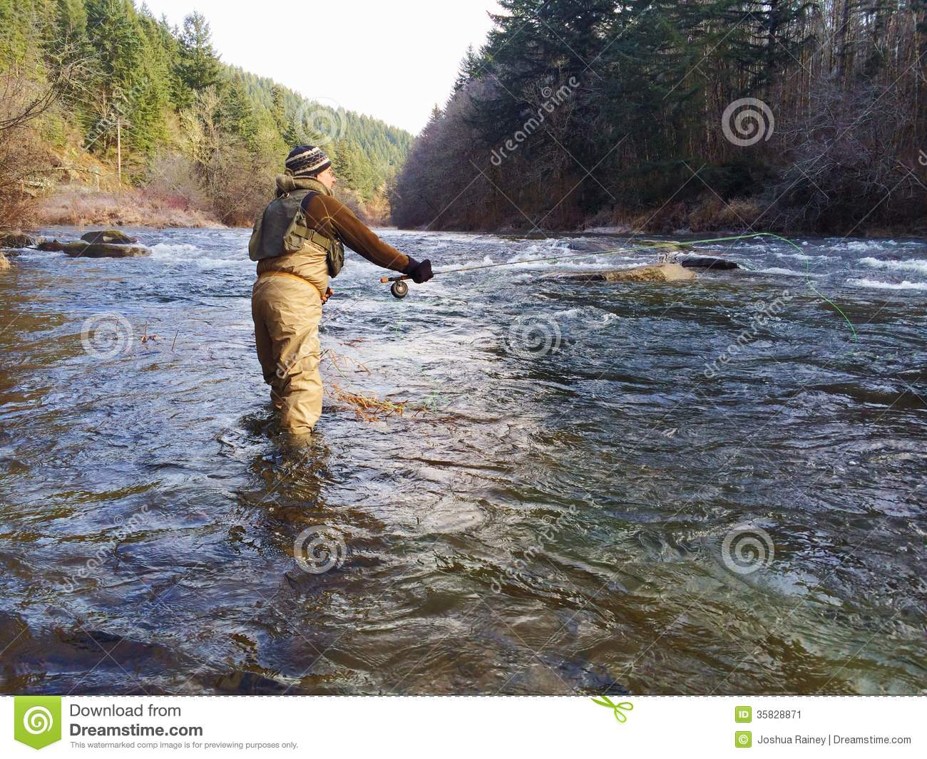 Man fly fishing in cold winter weather stock image image for Fly fishing casting