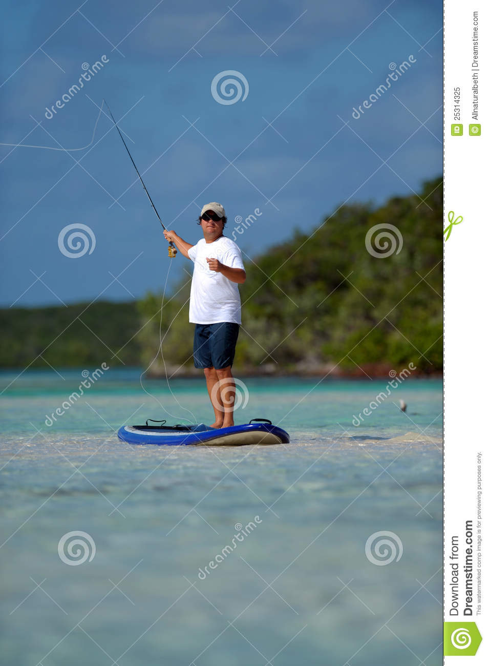 Man fly fishing on a paddle board royalty free stock photo for Fly fishing paddle board