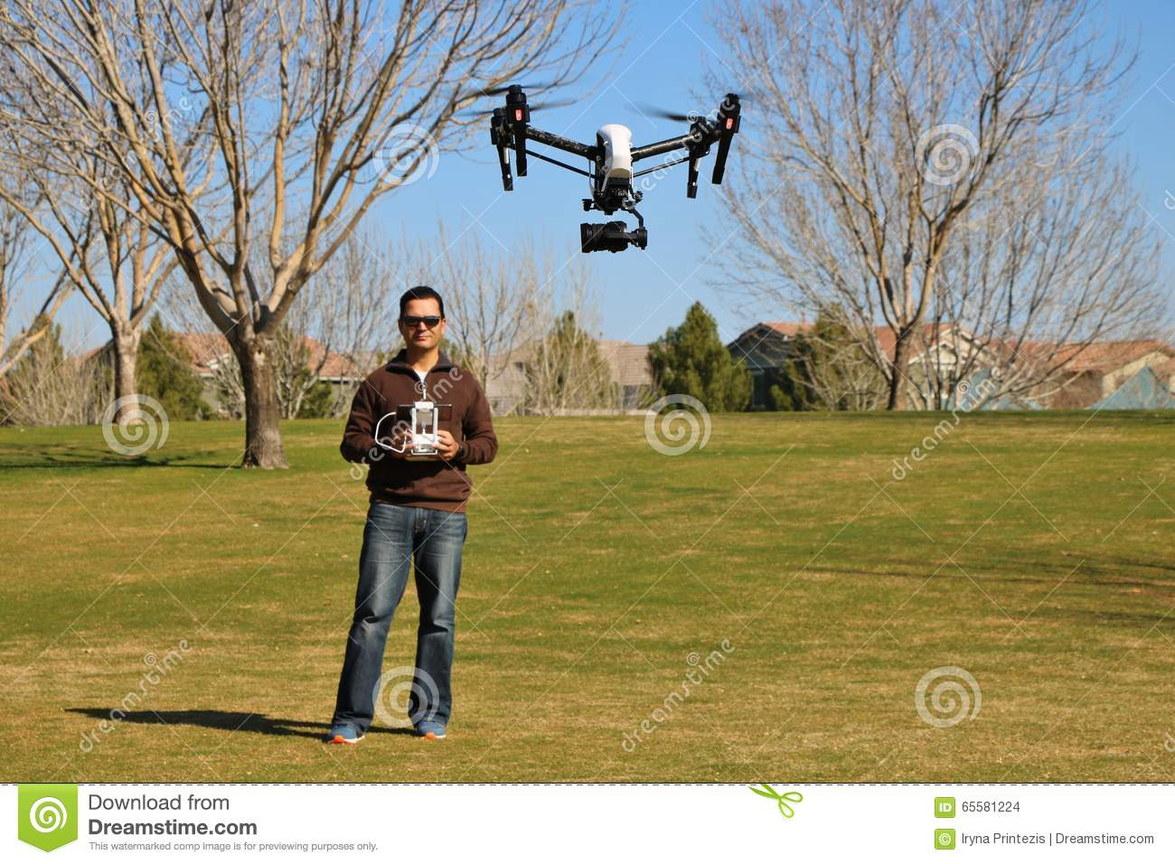 Man Flying a High-Tech Camera Drone