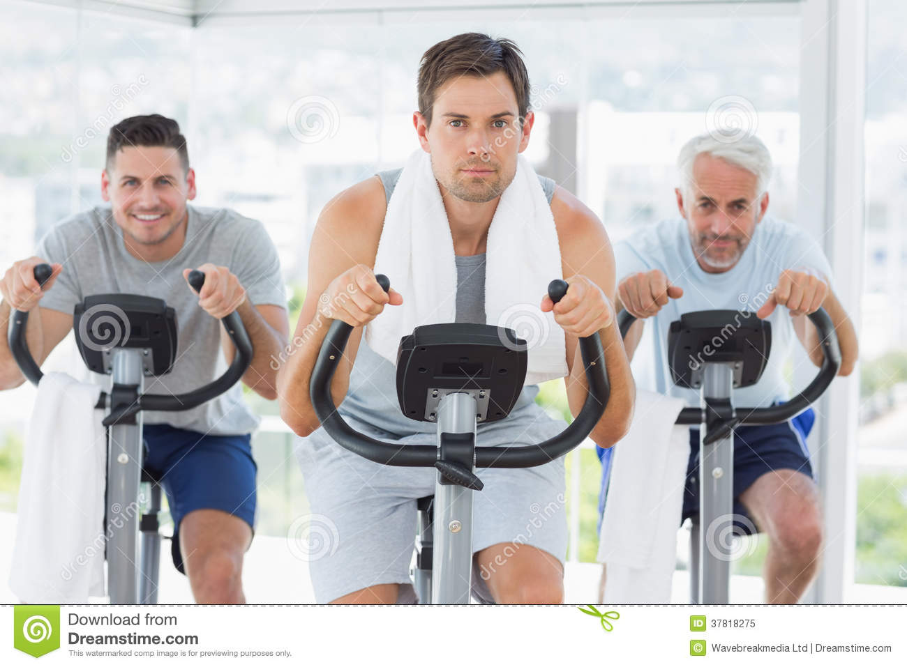 man with friends on exercise bikes royalty free stock photo image 37818275. Black Bedroom Furniture Sets. Home Design Ideas