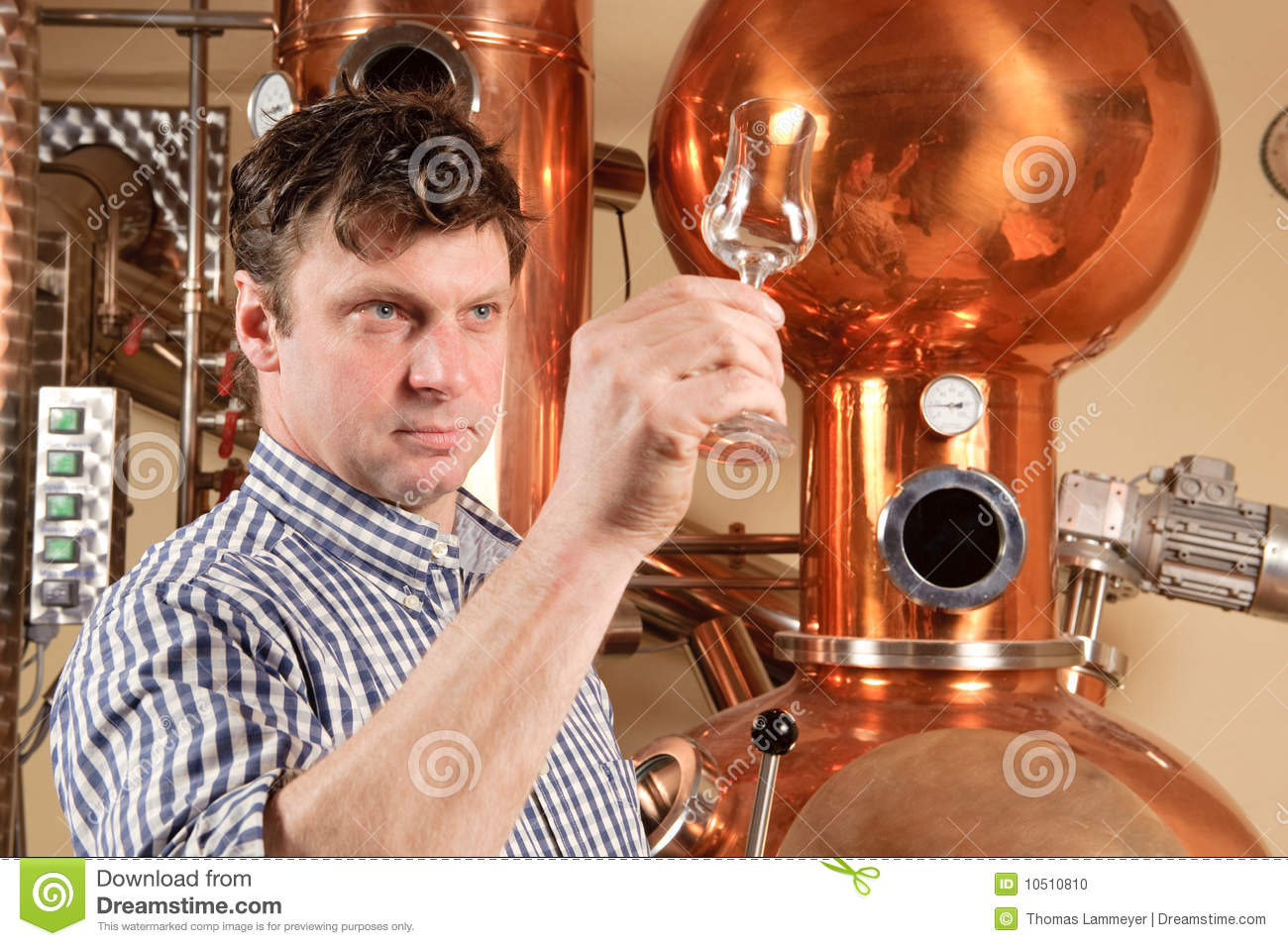 Man in front of distillery