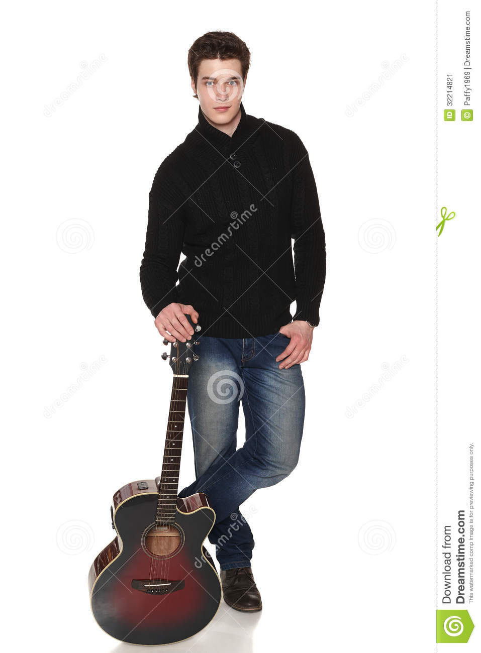 Man In Full Length Standing With Acoustic Guitar
