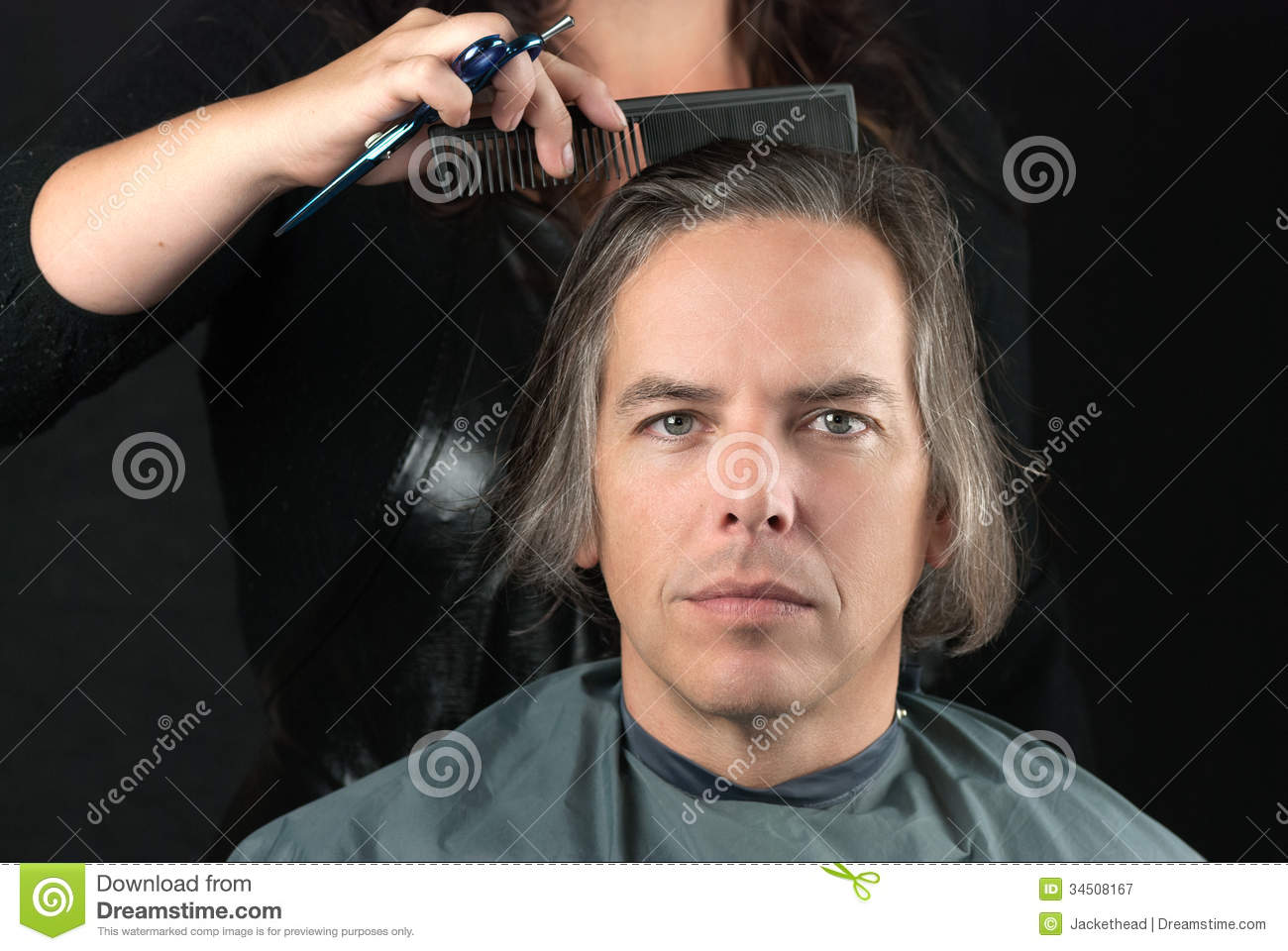 Man Getting Long Hair Combed In Preparation For Cut Stock Image