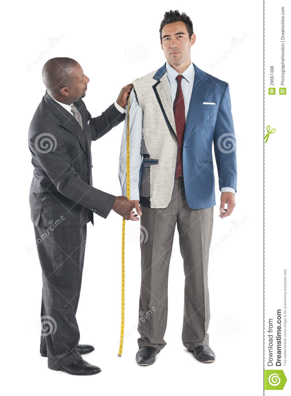 Man Getting Measured By A Tailor On A White Background Royalty Free Stock Photos