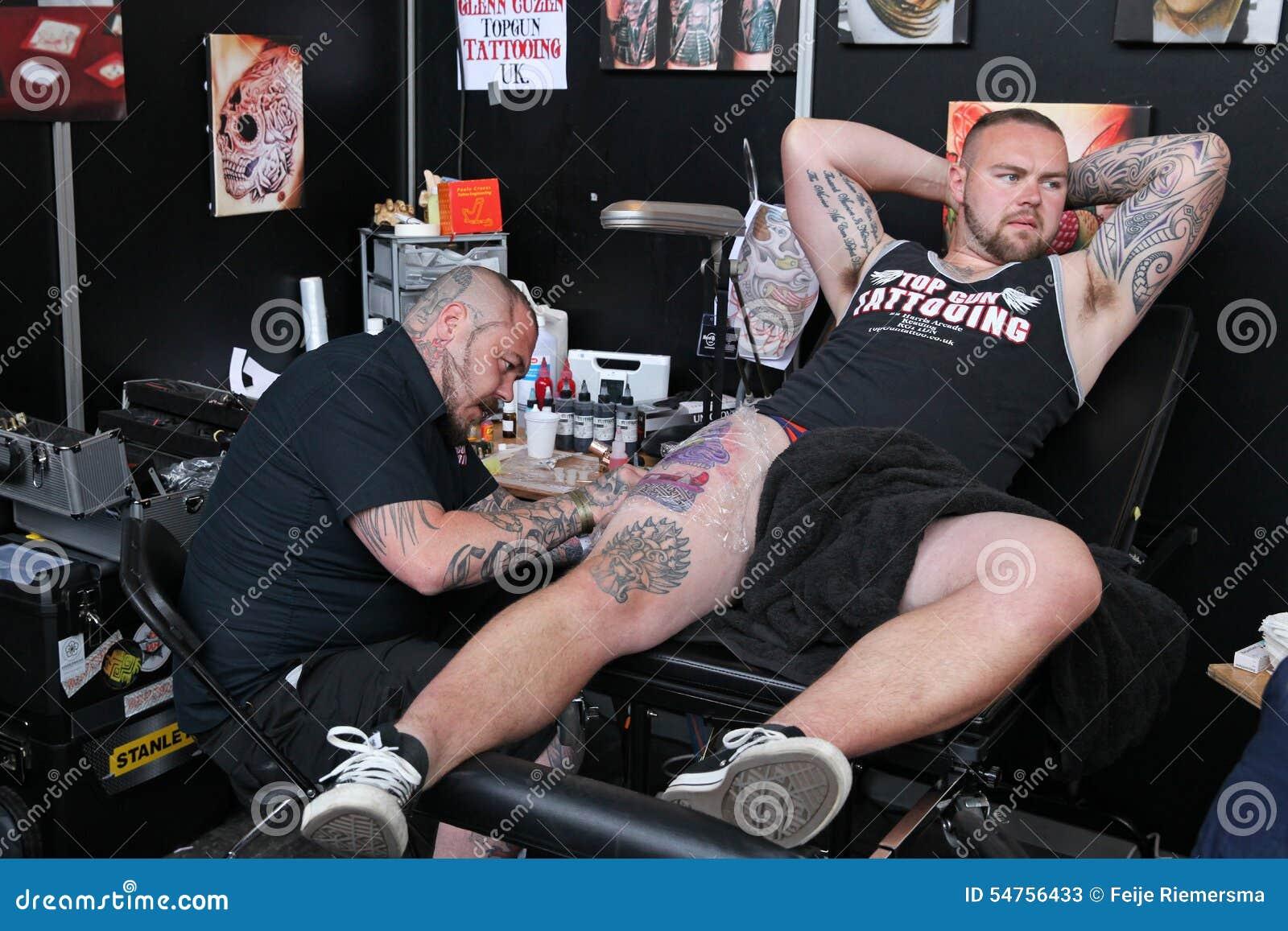 Man Getting A Tattoo, At A Tattoo Studio Editorial Stock ...