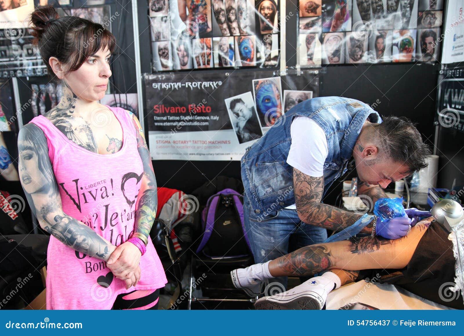 Man Getting A Tattoo, At A Tattoo Studio Editorial ...