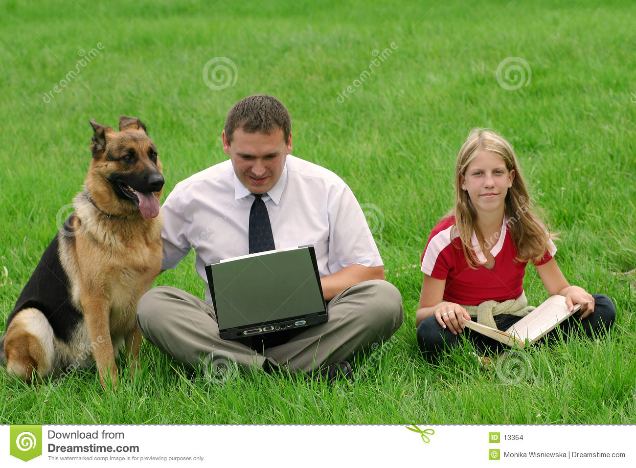 Man, girl and dog sitting