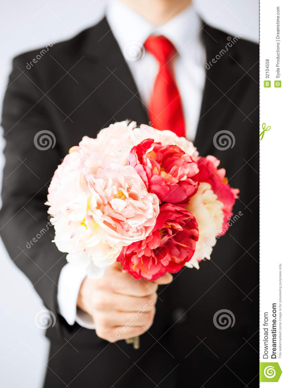 Cute bouquet of flowers for a man pictures inspiration wedding and man giving bouquet of flowers stock photo image of male closeup izmirmasajfo Gallery