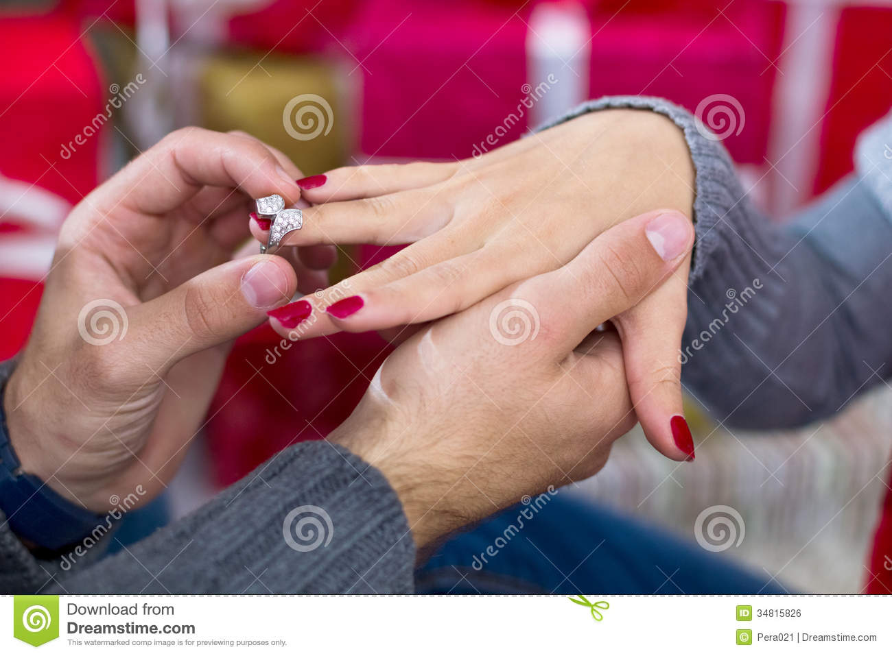 Man Giving An Engagement Ring To His Girlfriend Stock Photo Image