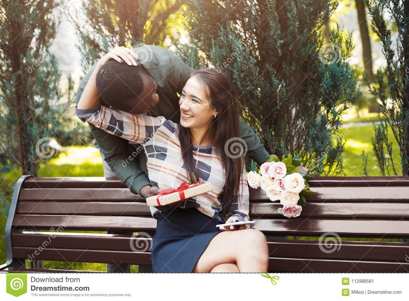 Man giving flowers and gift for his girlfriend