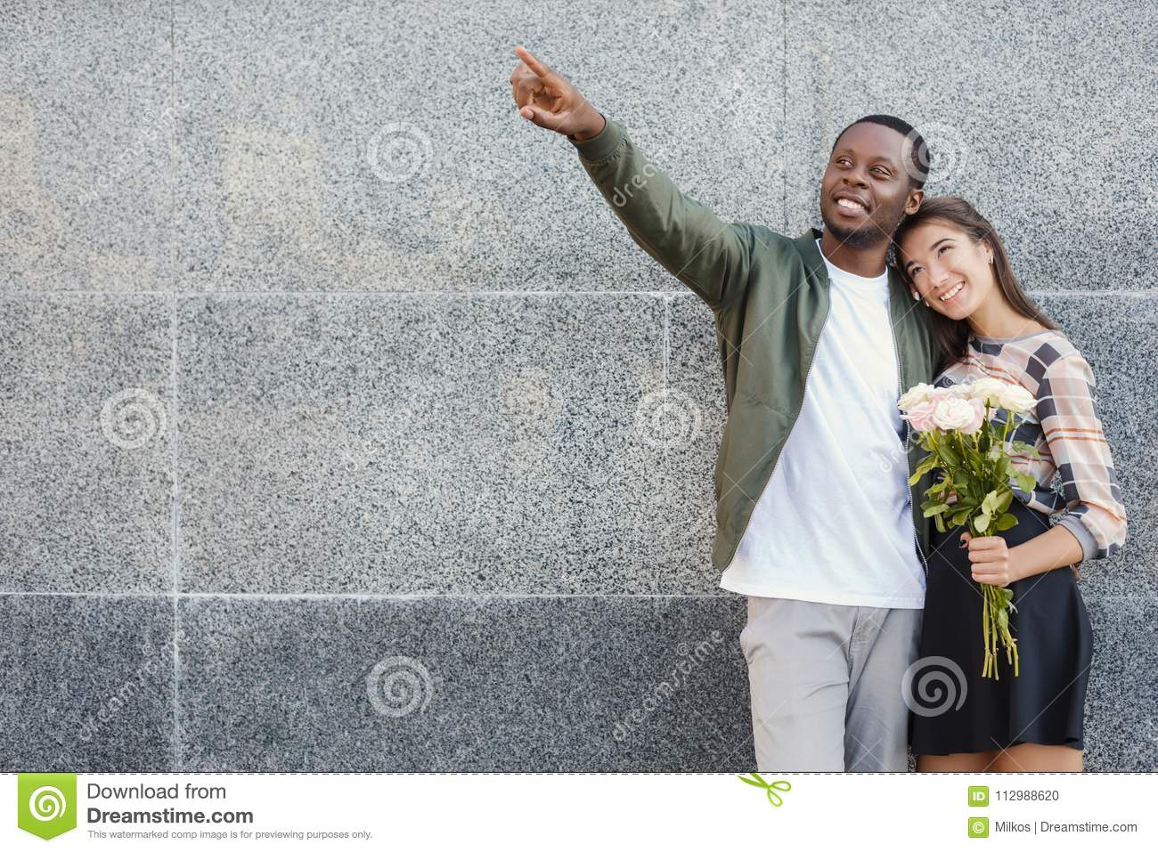 Man giving flowers for his beautiful girlfriend