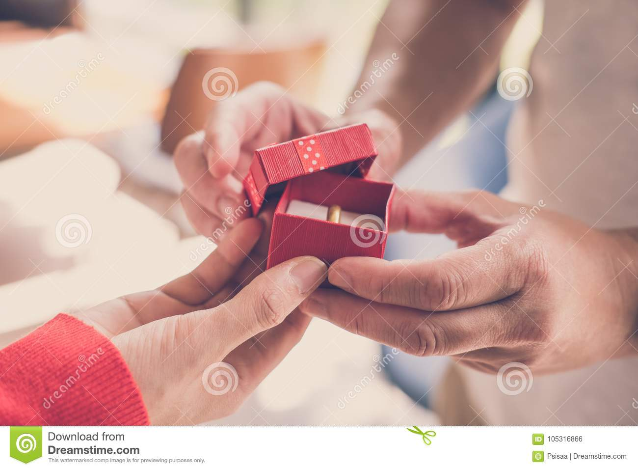 Man Giving Gift Box With Engagement Ring To Woman. Boyfriend Mak ...