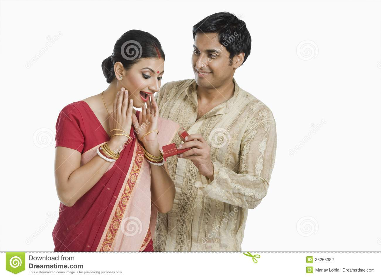 Man giving gift to his wife stock photo image of boyfriend man giving gift to his wife negle Choice Image