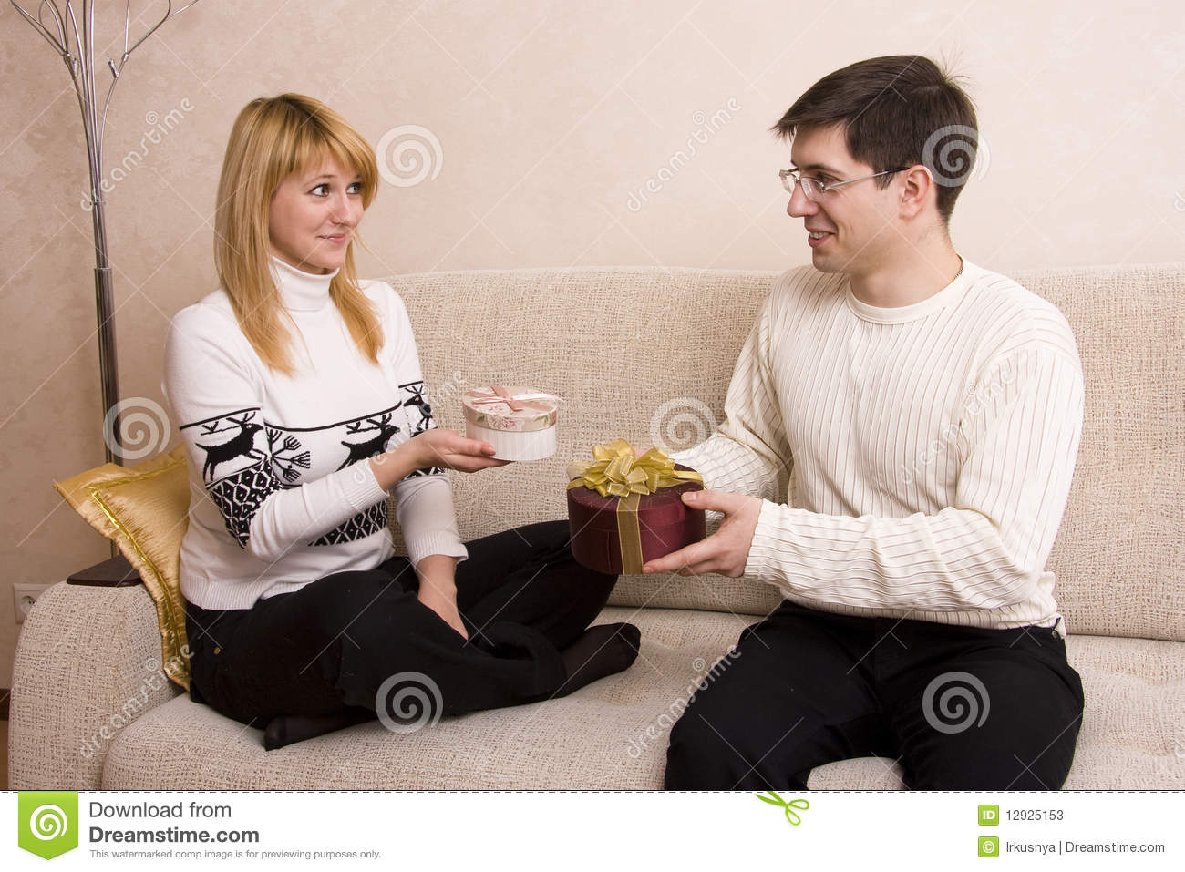 Man is giving gifts woman at Valentine?s day.