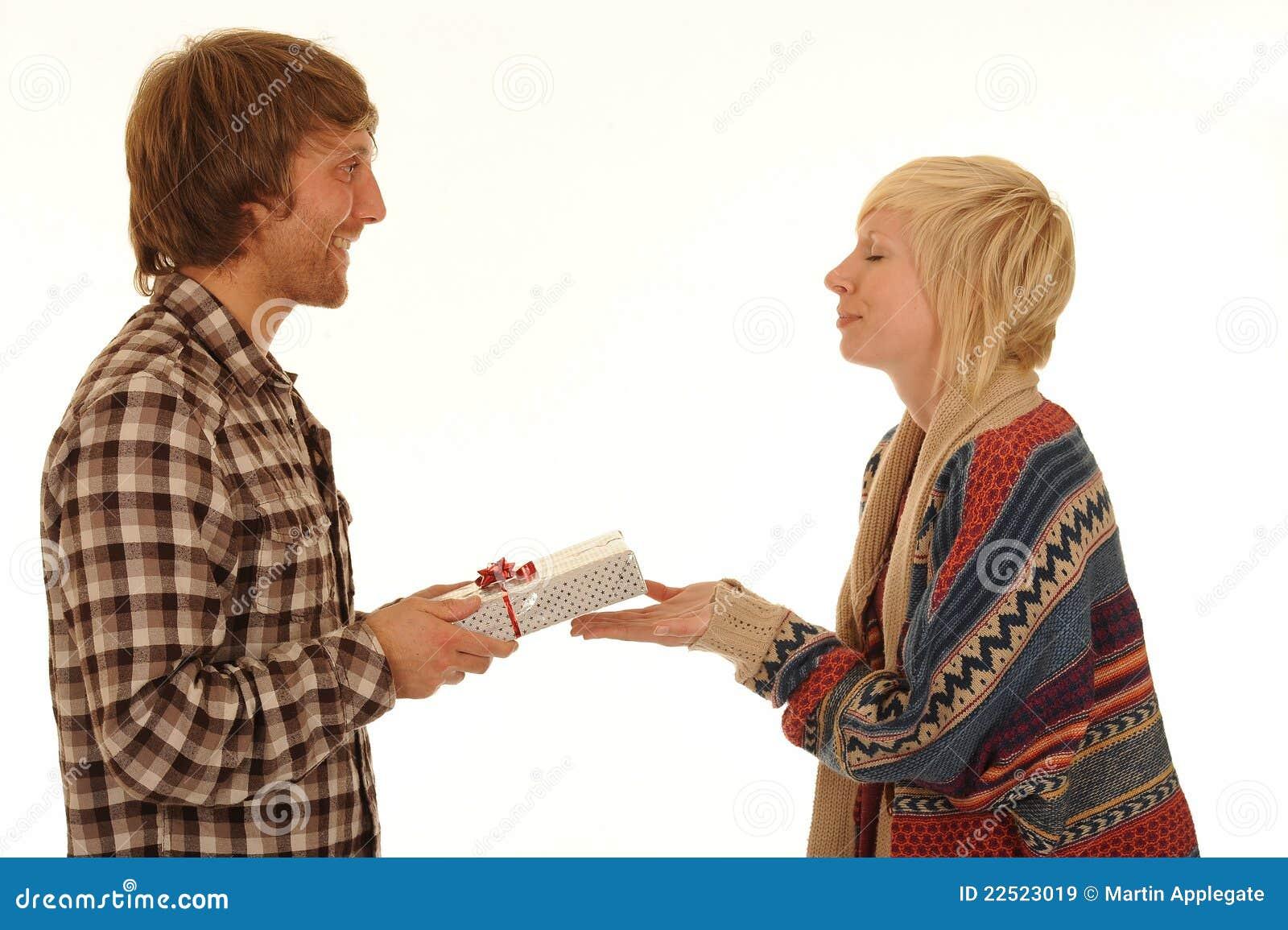 Man giving girlfriend present