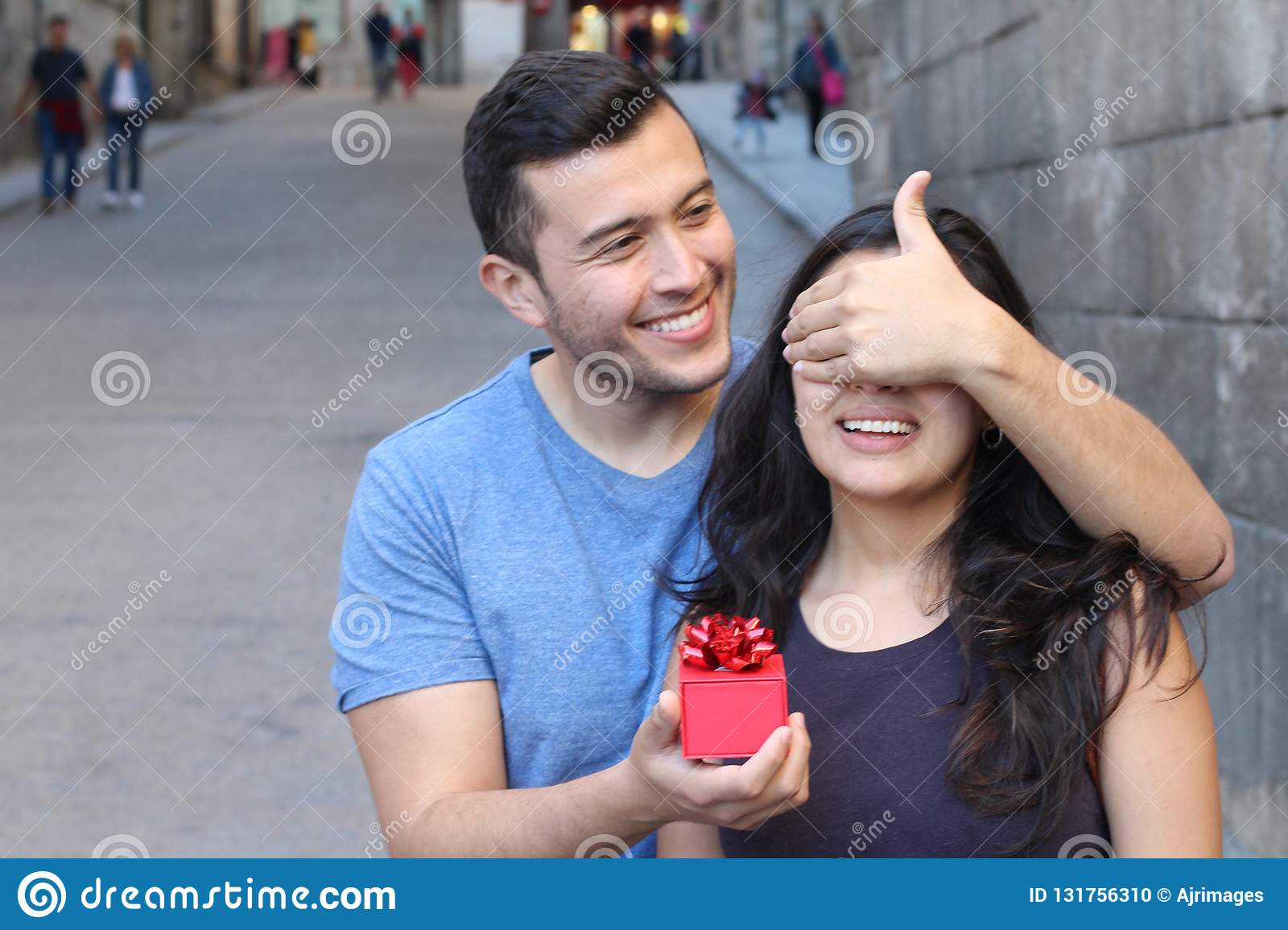 Man giving a present to a gorgeous woman