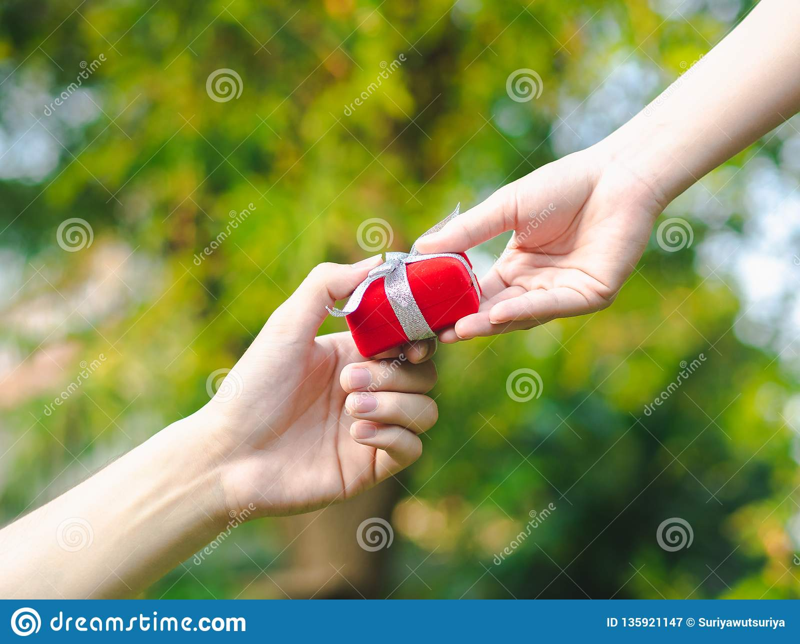 Man giving a red gift box to woman. Love, Valentine,Present Concept