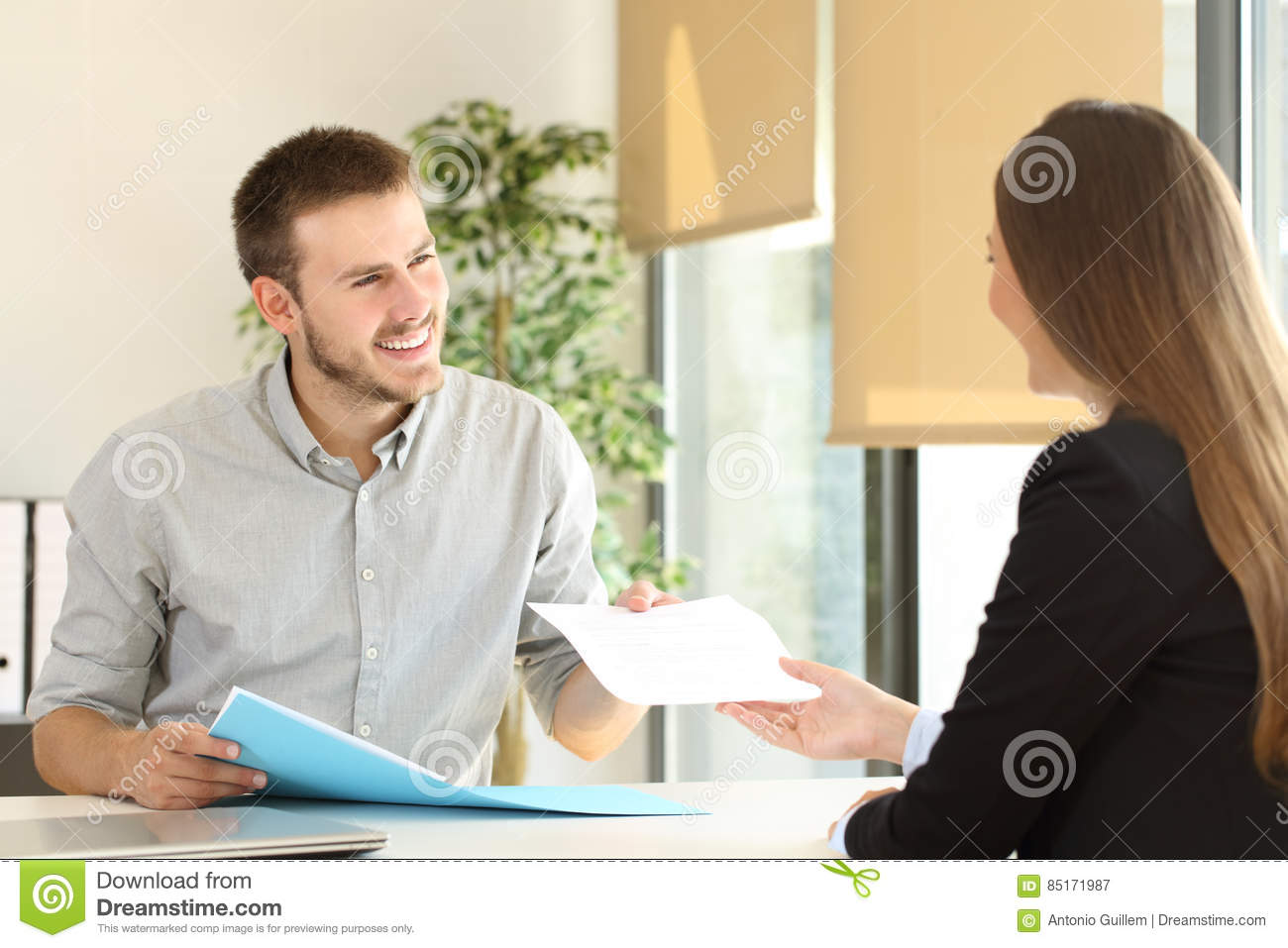 man giving resume in a job interview stock image