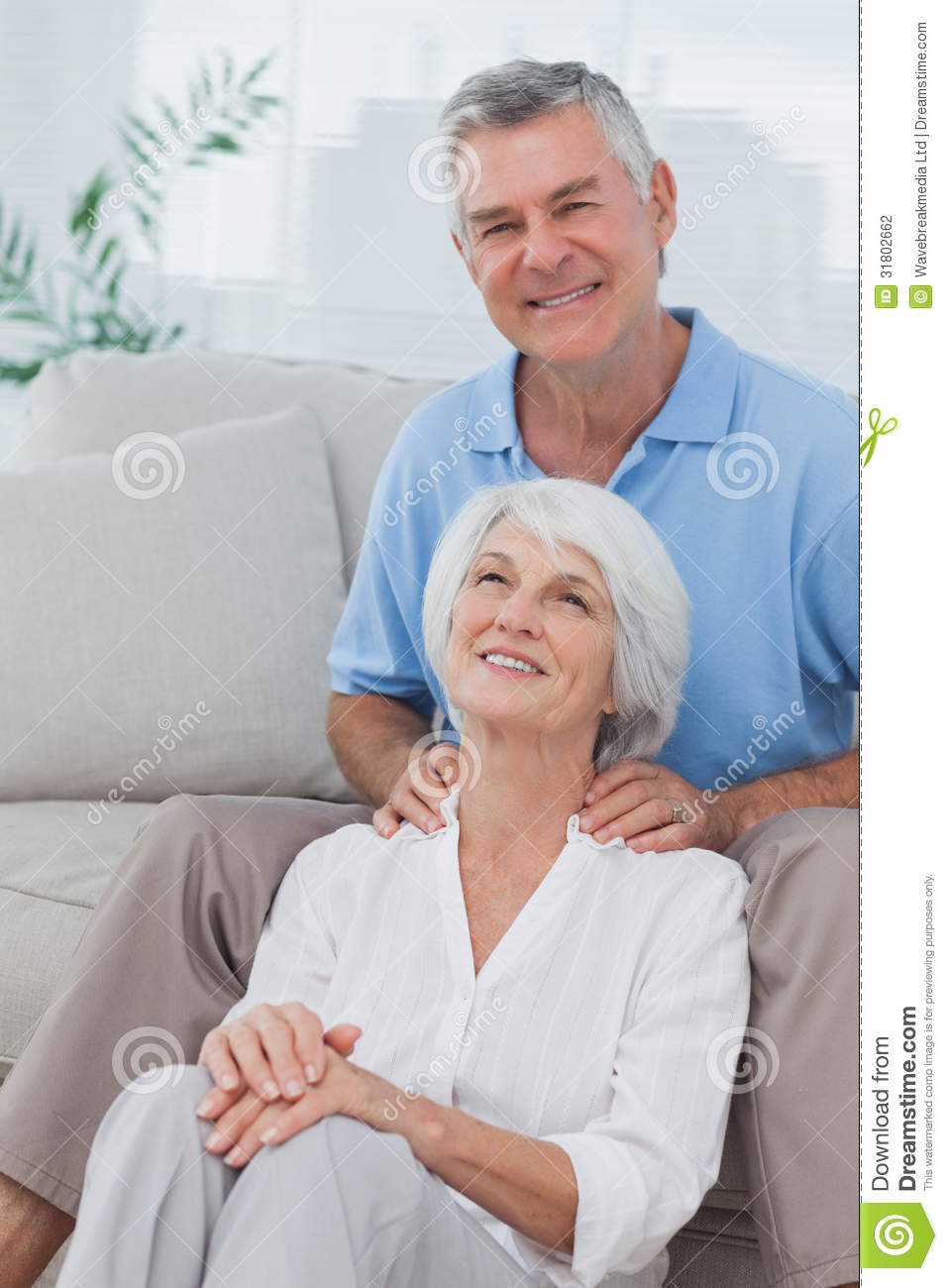 Mature men giving shoulder massage to wife