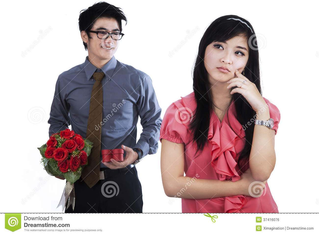 A man giving a surprise gift to girlfriend stock photo image royalty free stock photo negle Choice Image