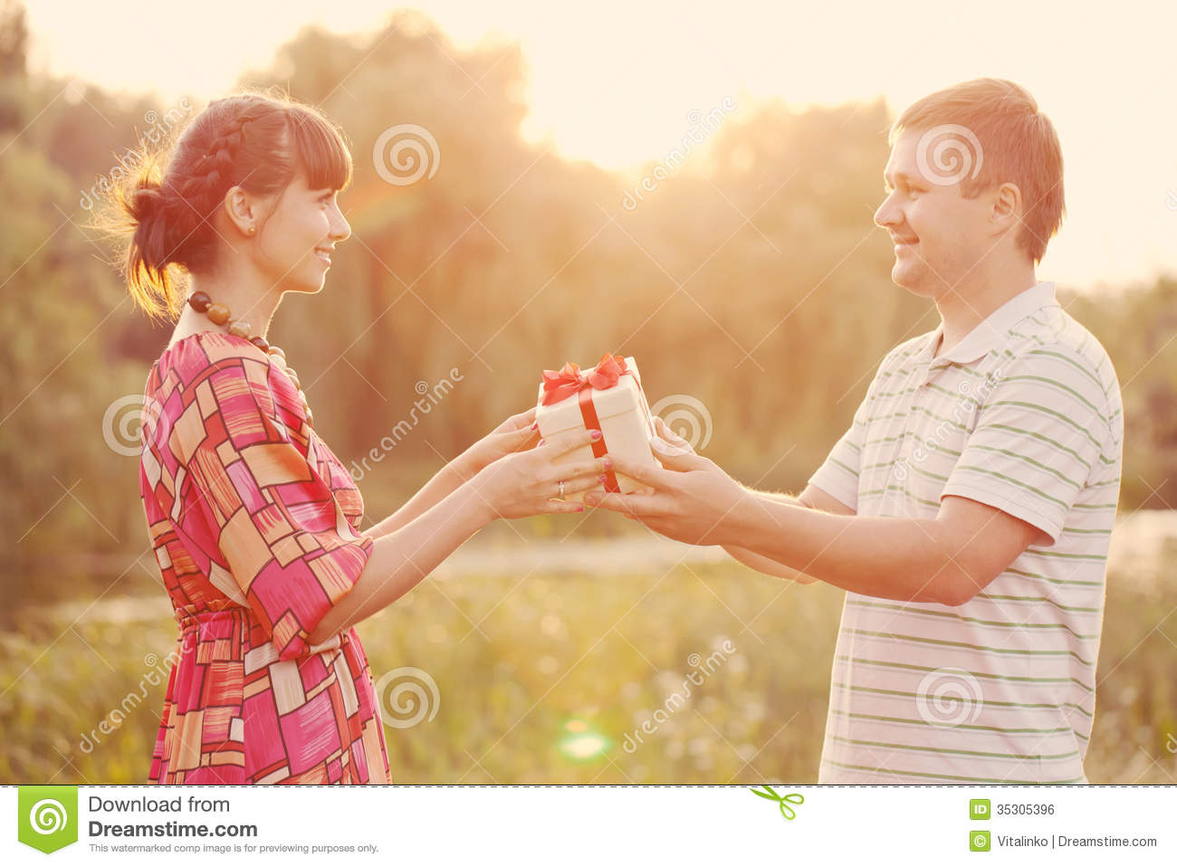 Man Giving To His Woman A Gift Box Retro Style Royalty