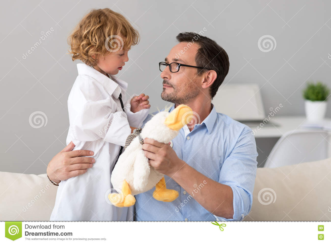 Man Giving Toy To His Little Doctor Stock Image - Image of care ...