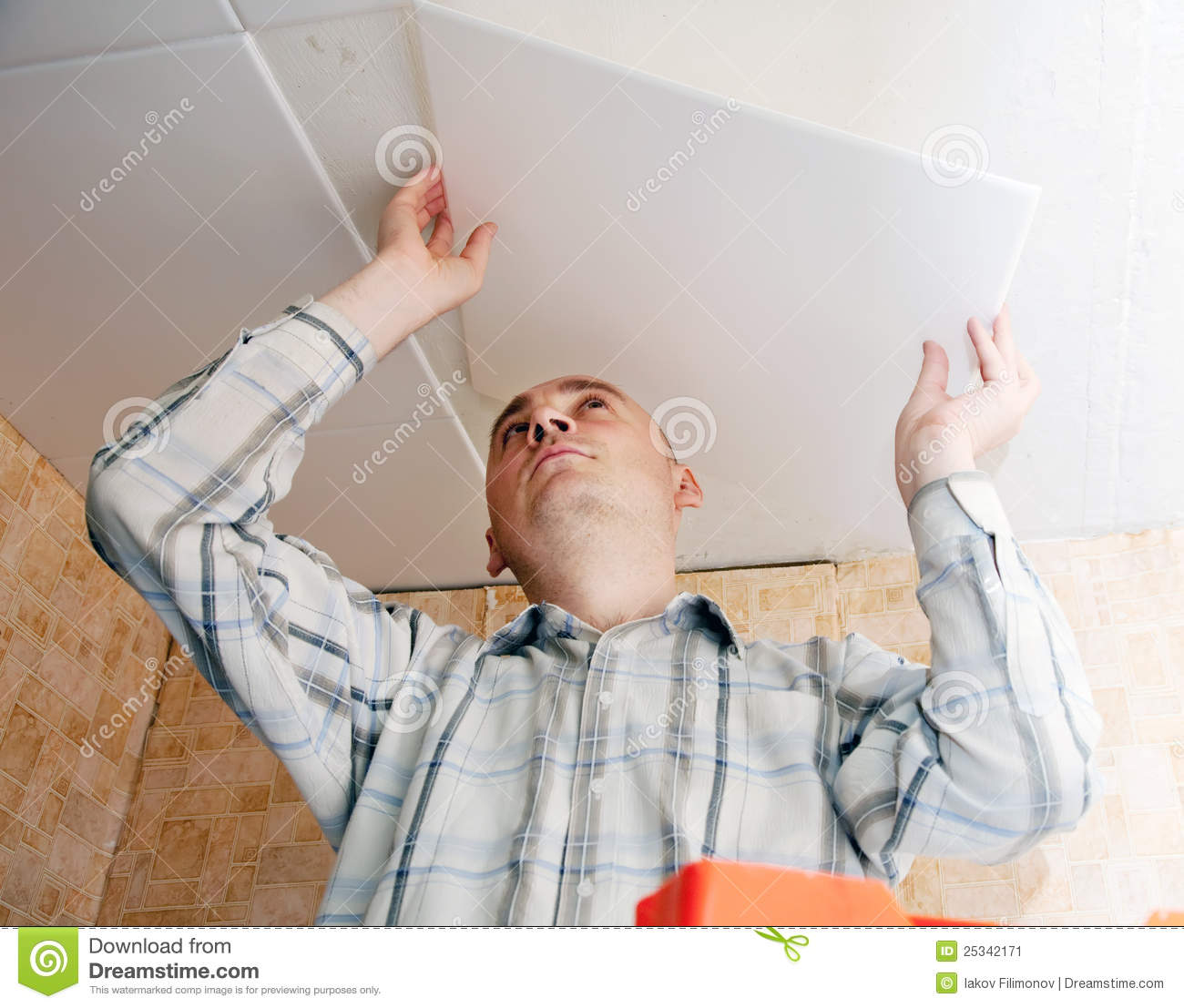Man Glues Ceiling Tile At Kitchen Stock Image Image Of Renovations