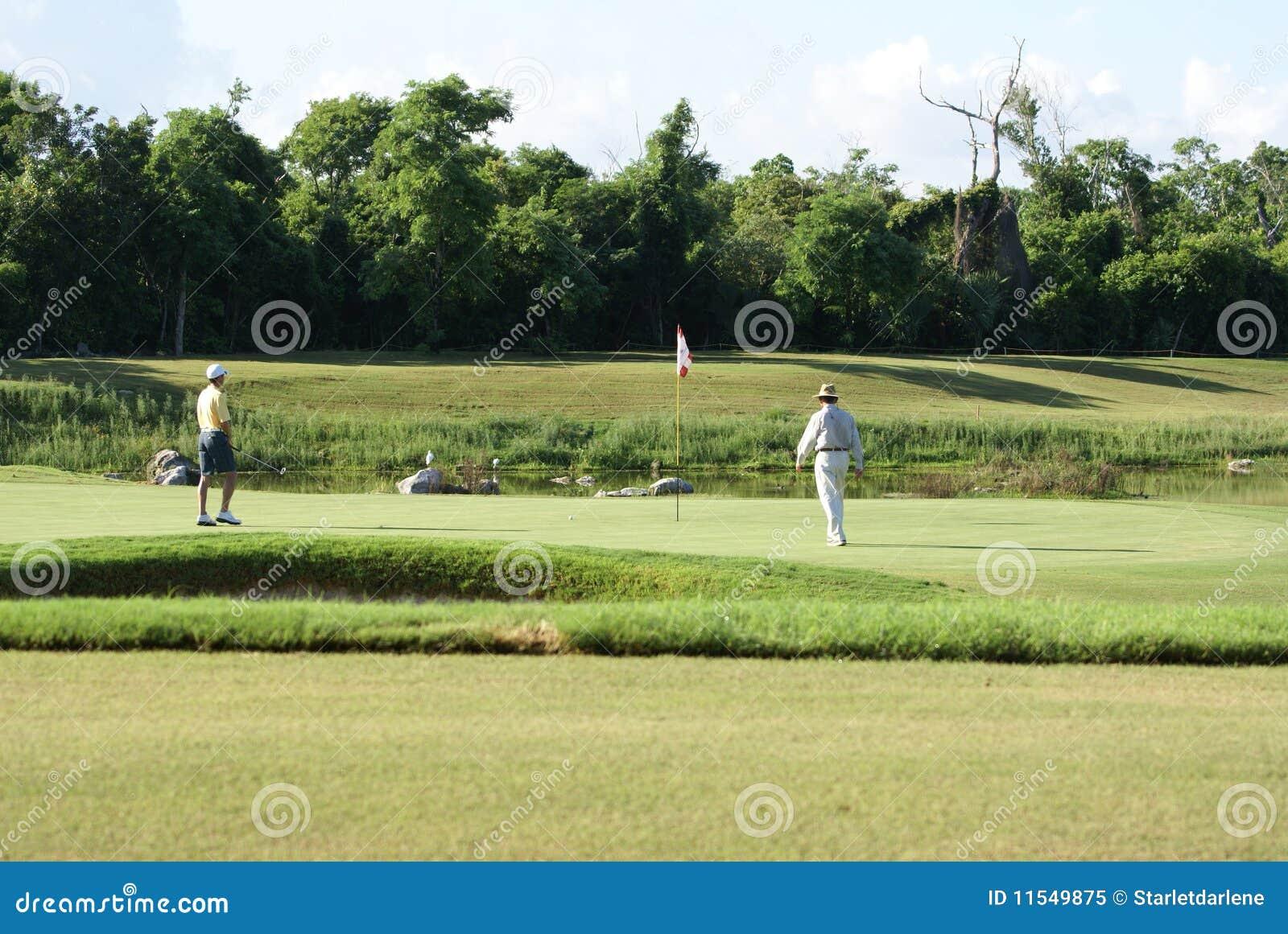 Man Golfing with Caddy