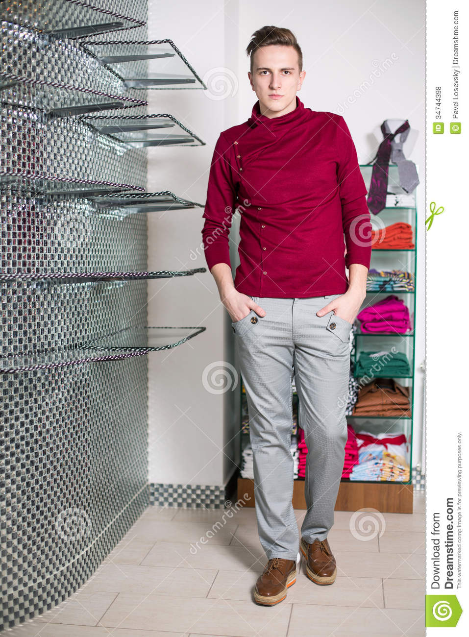 The Man In Gray Pants And A Red Sweater Stock Photo ...