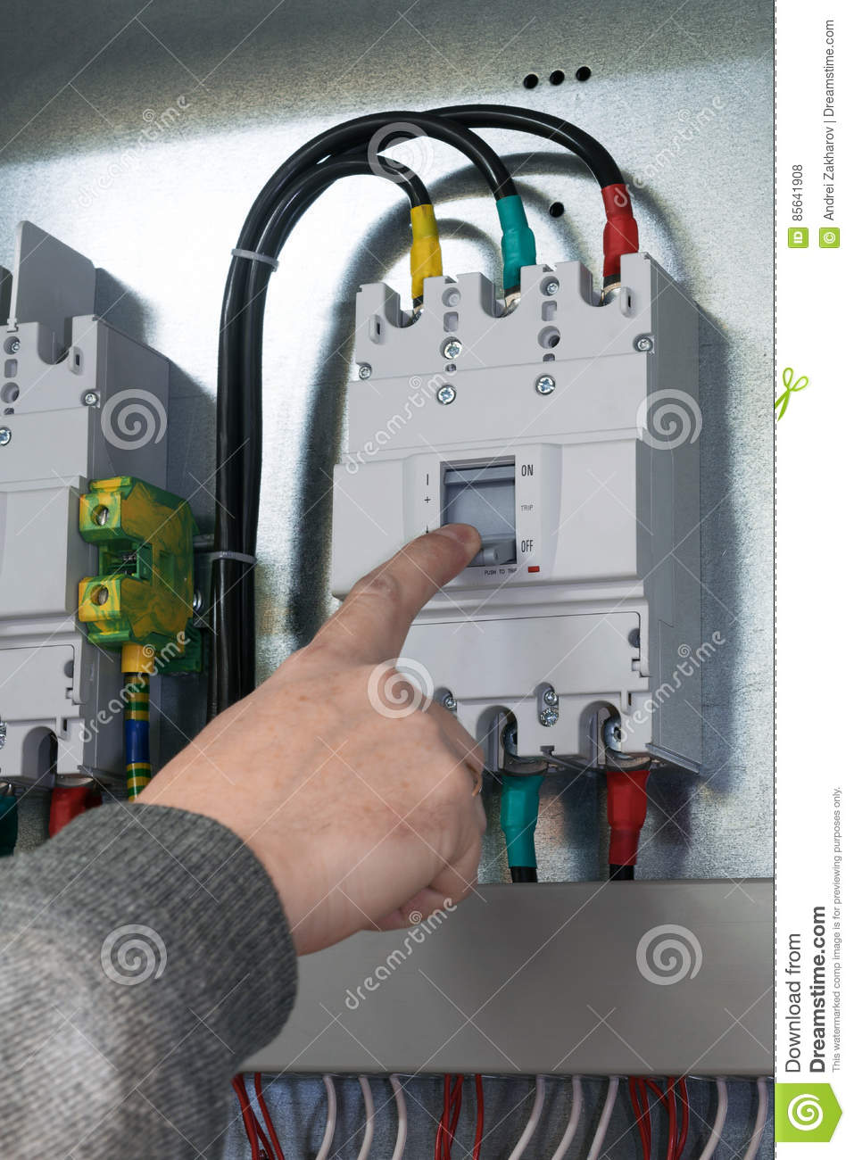 A Man In A Gray Pullover Hand Off The Power Circuit Breaker Is ...