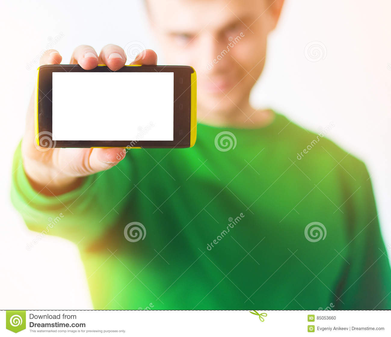 Man in greenery sweatshirt smile, Hand holding smart phone with