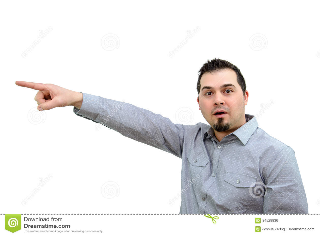 Man in Grey Shirt pointing Expressively on white backdrop