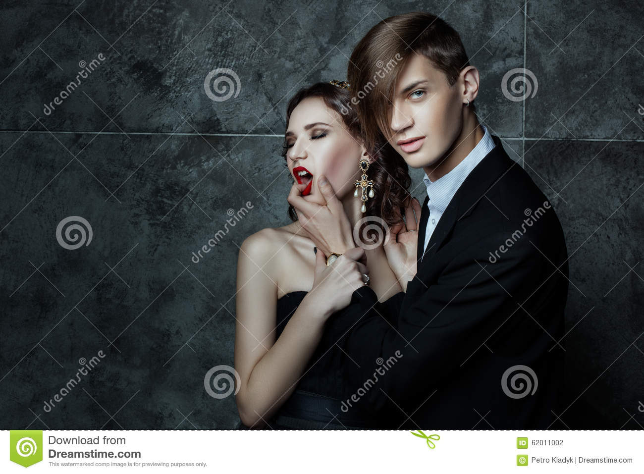 man putting fingers in womans mouth