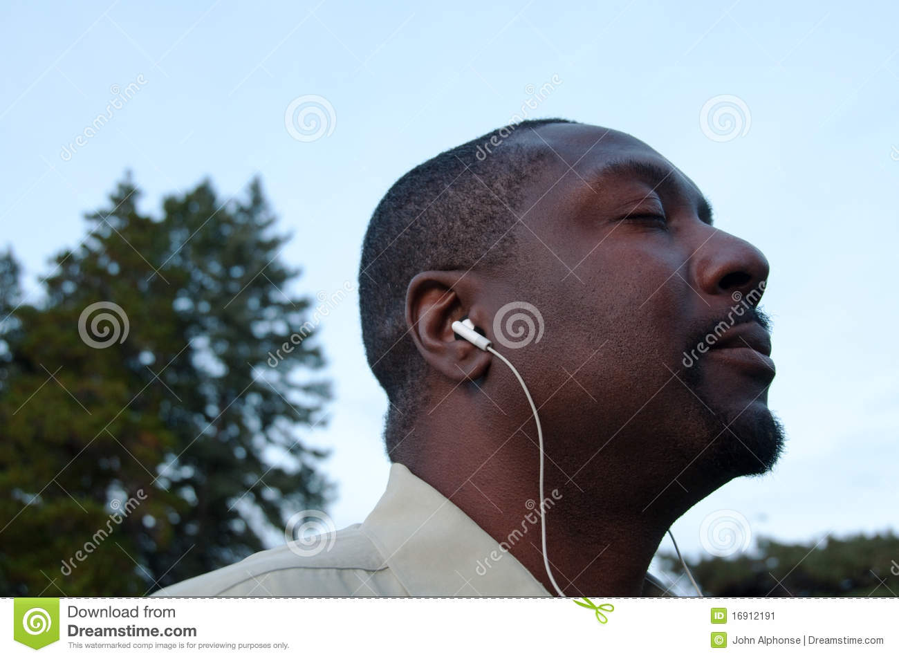 Stock Image Man Grooving To Music Wearing Earbuds Image16912191 on man alarm clock