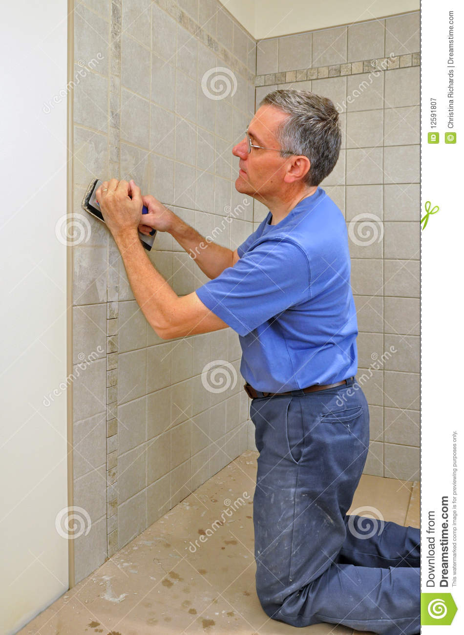 Man Grouting Ceramic Tile In Bathroom Royalty Free Stock Photography Image