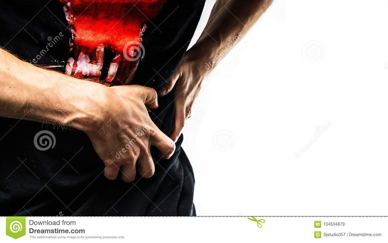 Man, guy in a black t shirt on a white background hold hands on his stomach, liver pain, pancreas, kidneys