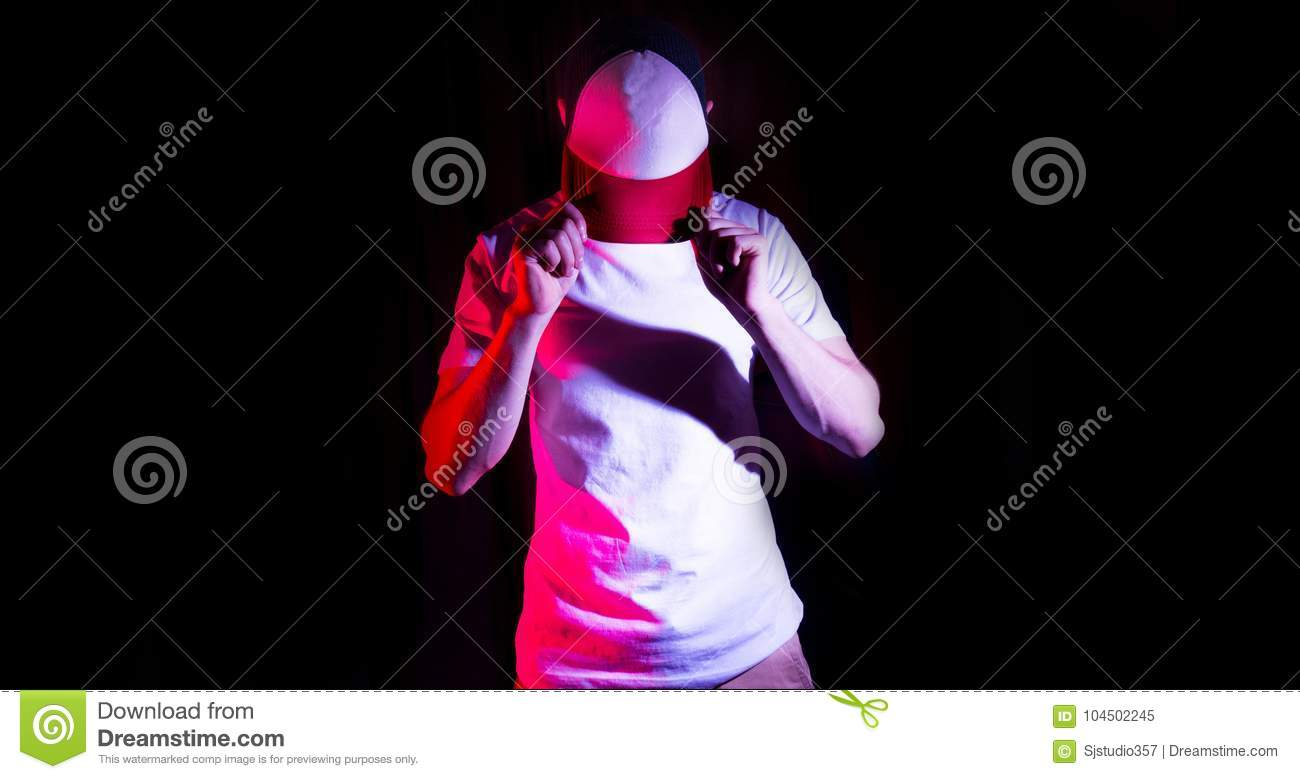 The man, guy in the blank white, red baseball cap, on a black background, mock up, free space, logo presentation , template for p