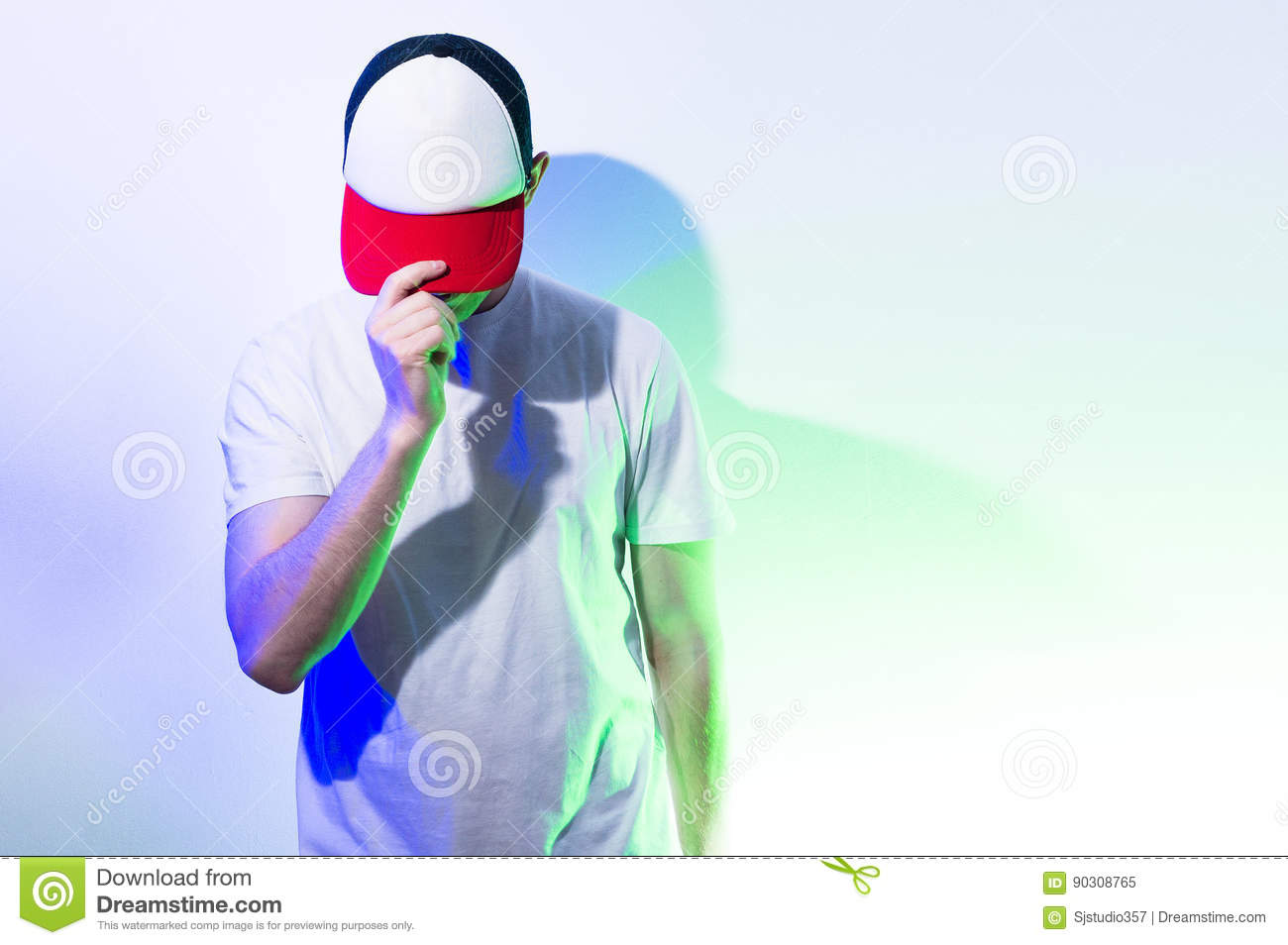 The man, guy in the blank white, red baseball cap, on a white b