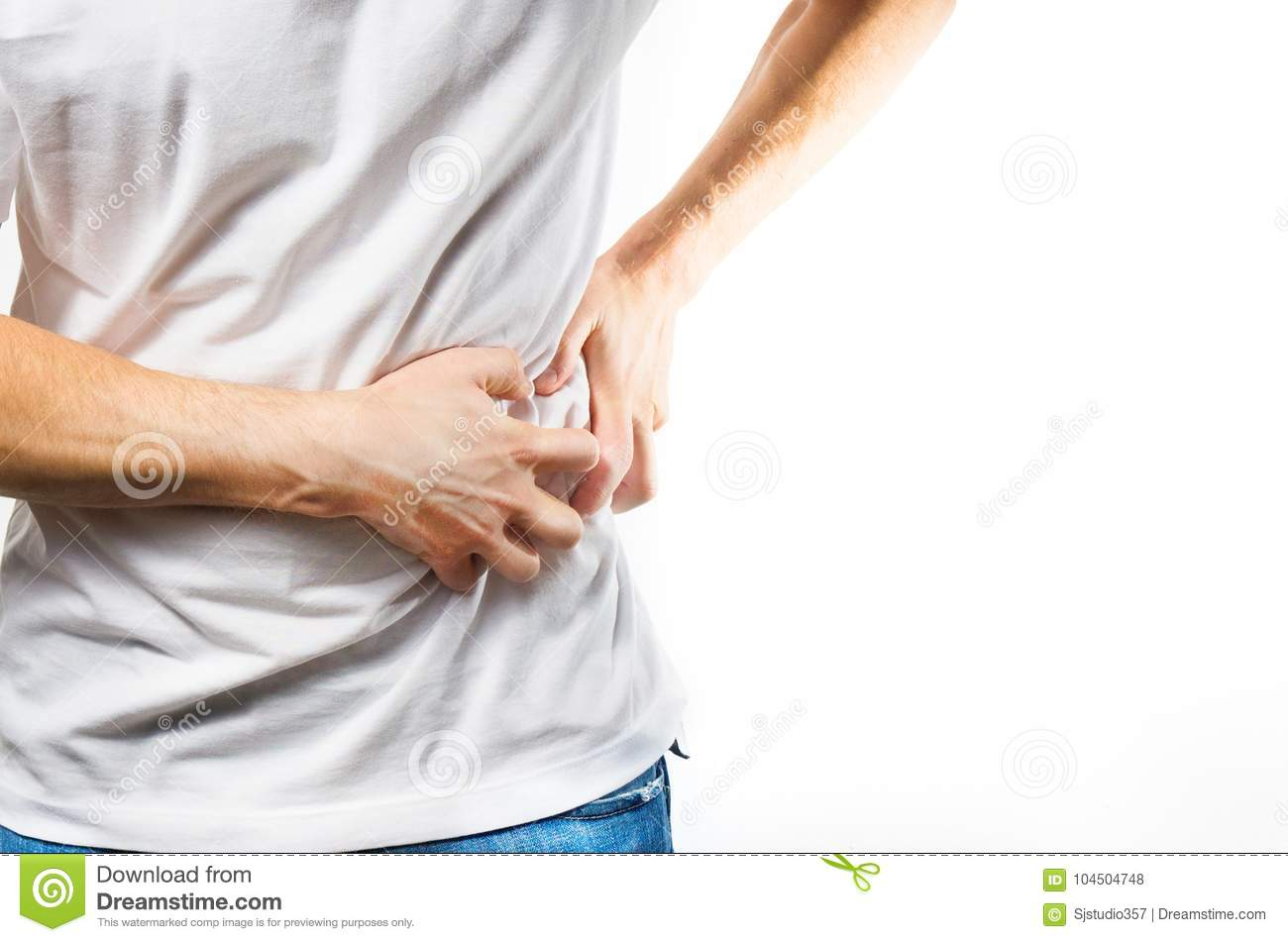 Man, guy in a white t shirt on a white background hold hands on his stomach, liver pain, pancreas, kidneys problems