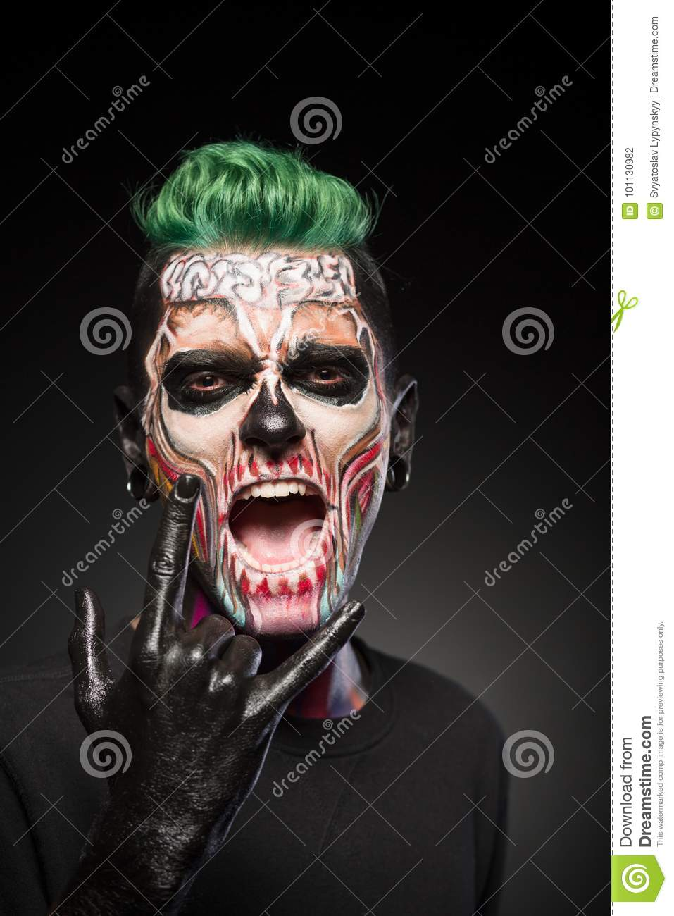 man with halloween makeup showing tongue. stock photo - image of