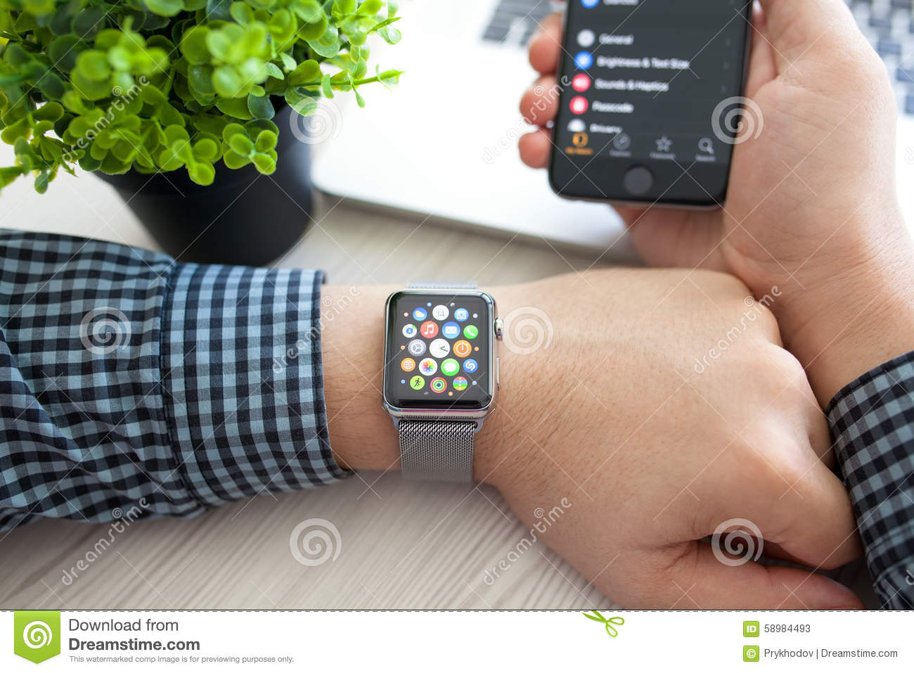 man hand with apple watch and app icon on screen editorial stock