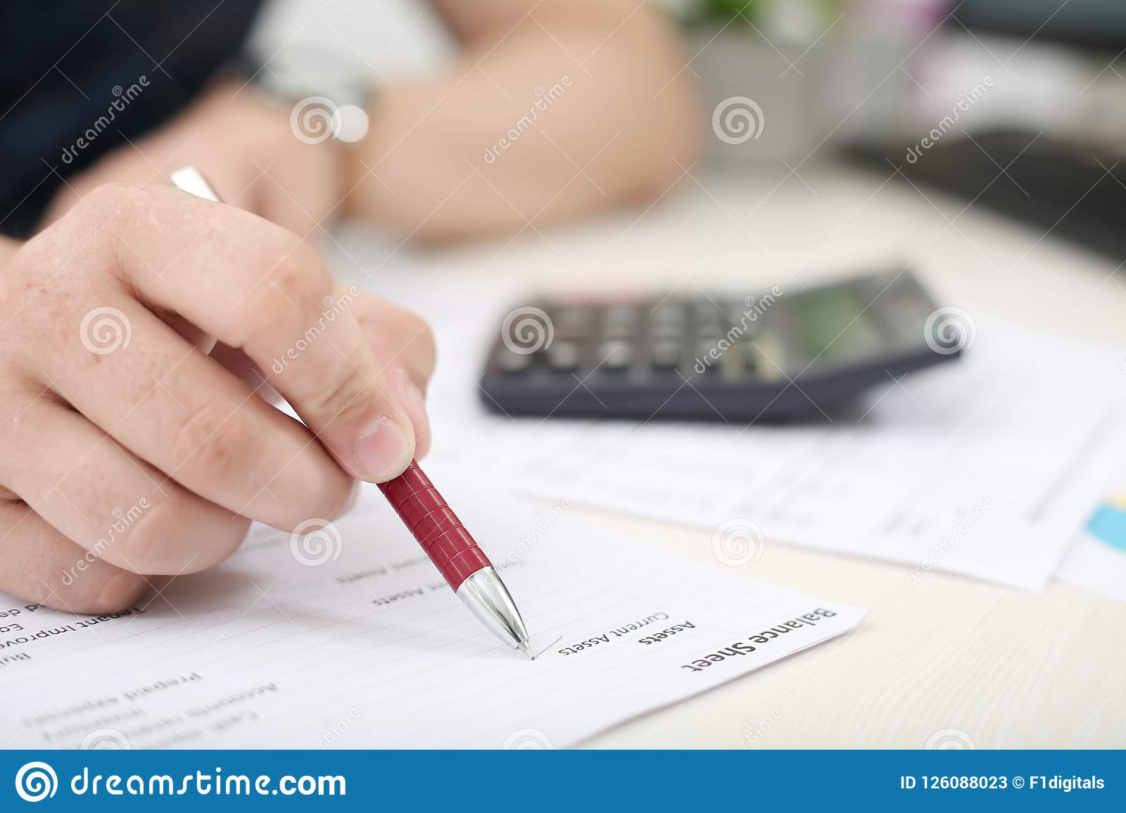 man hand is checking balance sheet with pen stock image image of
