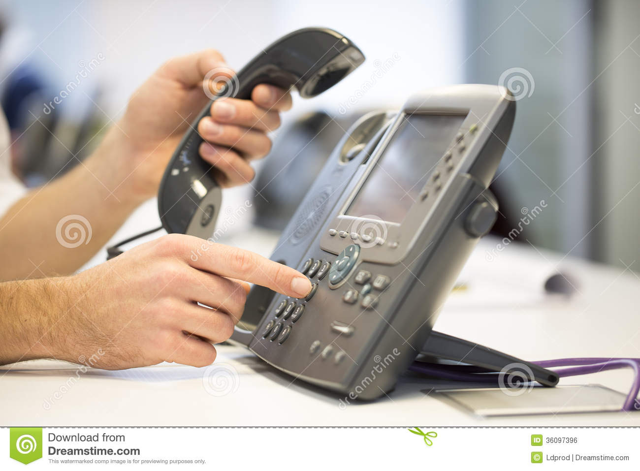 Man hand is dialing a phone number, office Background